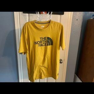 Yellow North face tee shirt